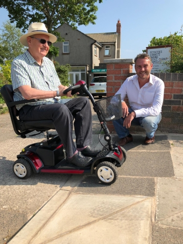 Cllr. Worthington and Mr. Hall show off Dalton Lane's new dropped kerb